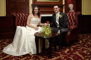 Bride and Groom relax for photograph at Elizabeth Orwell Hotel